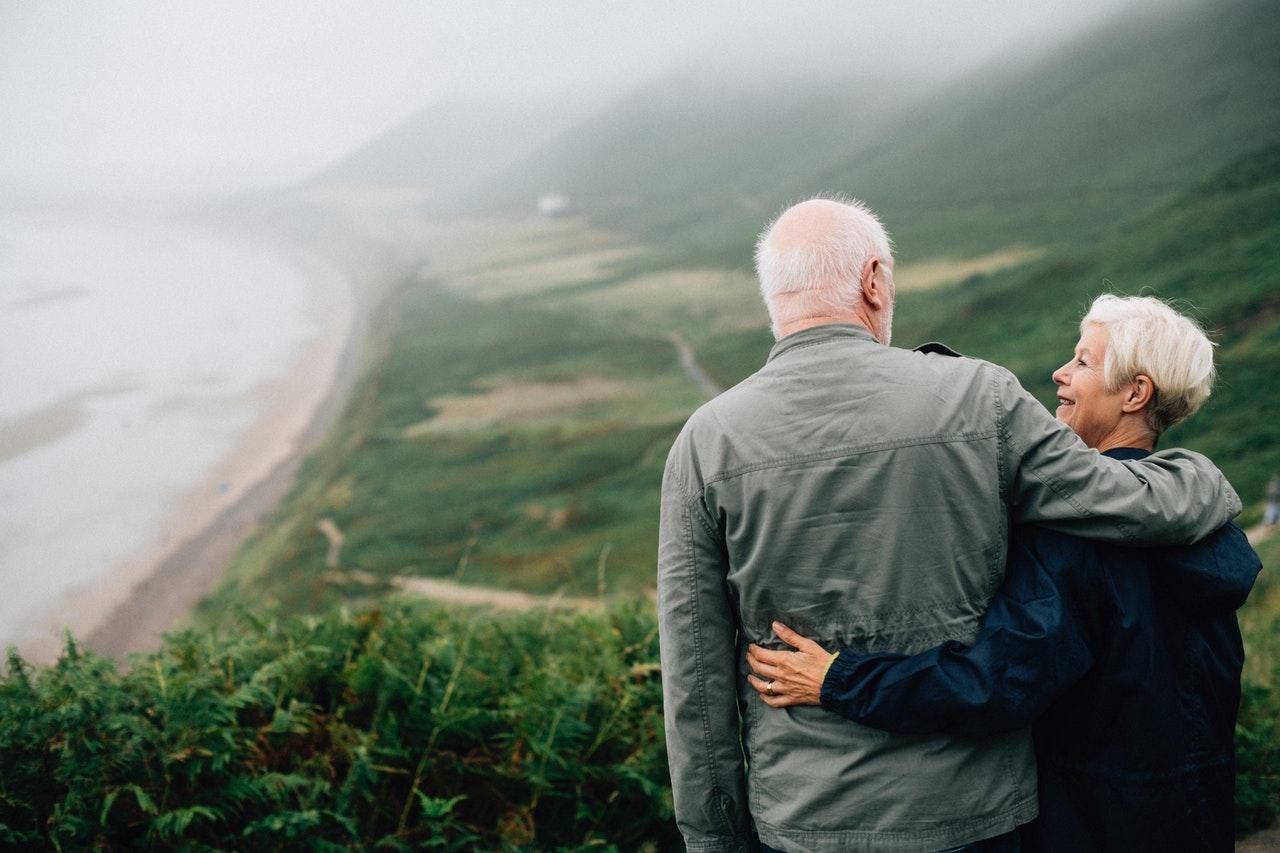 Elderly couple enjoying a walk outdoors