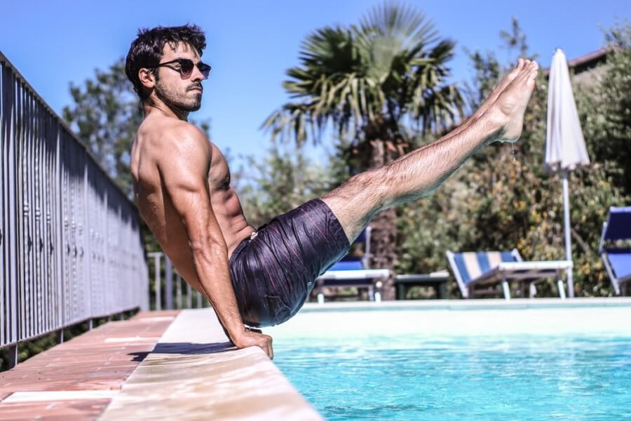 Unsplash: Calisthenics Pike Exercise By Swimming Pool