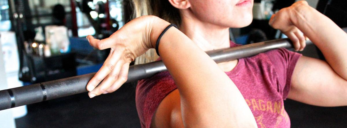 Stock image - women holding a barbell
