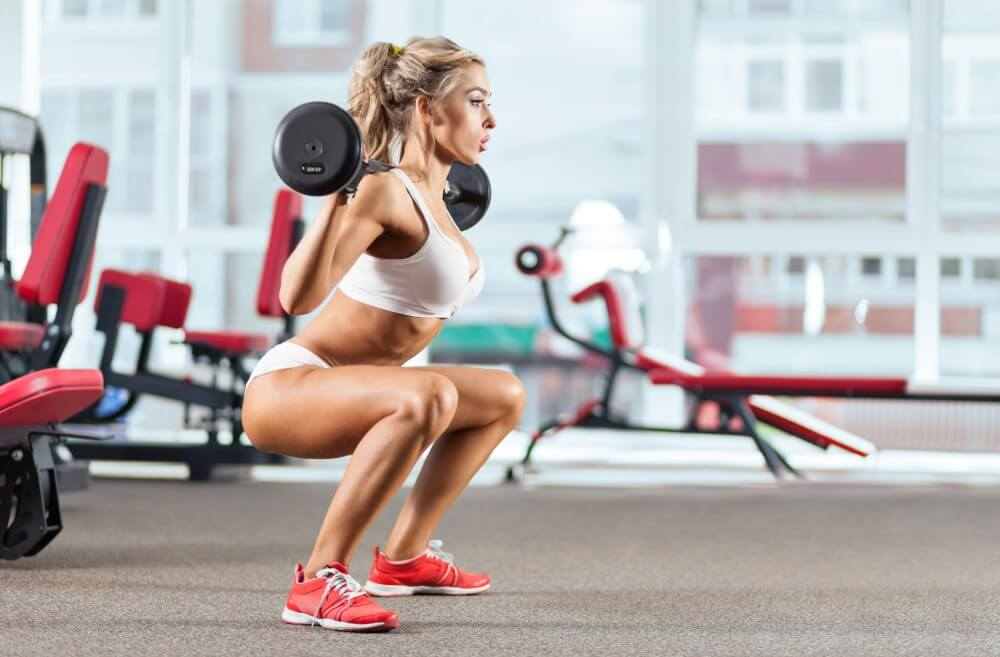 Woman performing barbell squat