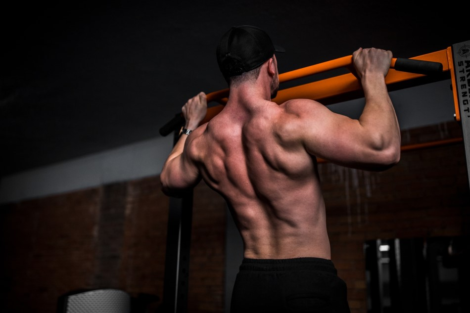 Stock image of a man doing a pull-up