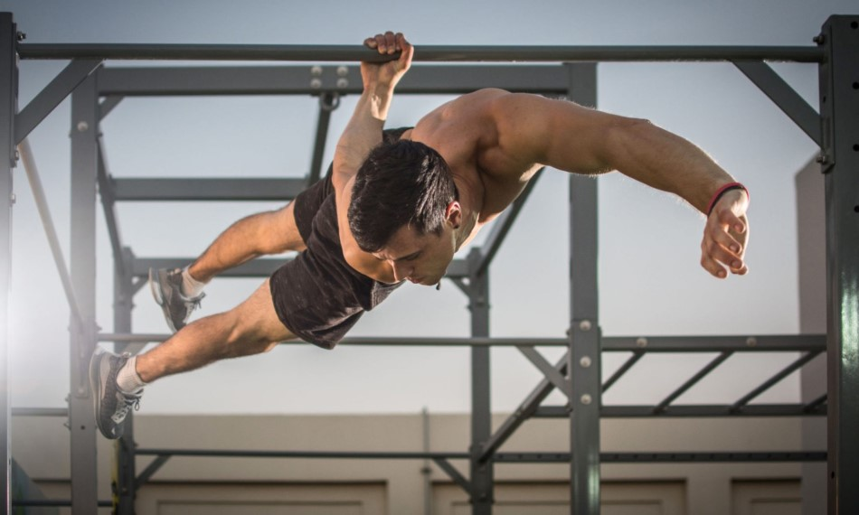 Man performing a one-arm back lever