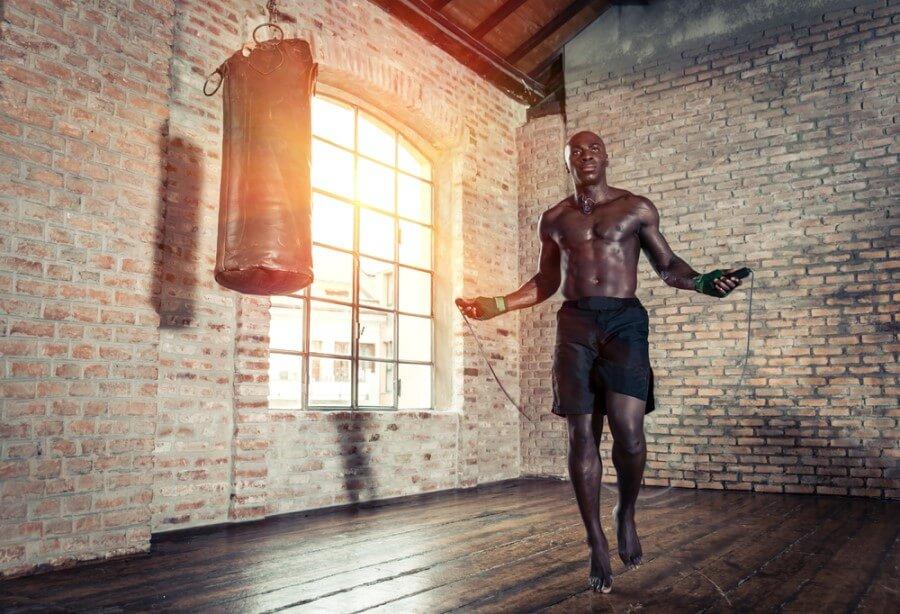 Man skipping in boxing gym